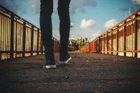 Man walking forward wearing sneakers
